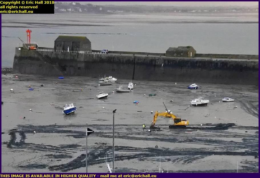 digger in tidal basin port de granville harbour manche normandy france