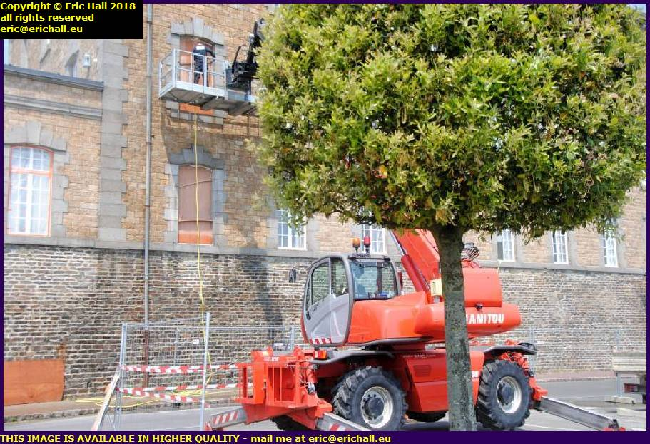 skyjack pressure washer washing walls place d'armes granville manche normandy france