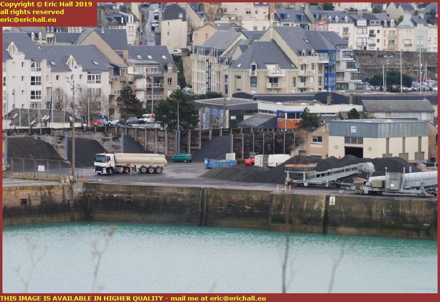 lorry unloading gravel port de granville harbour manche normandy france