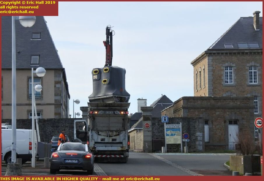 removing waste paper place d'armes granville manche normandy france