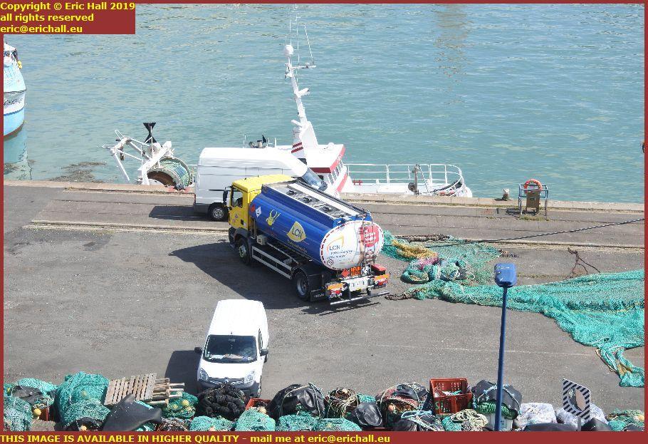fuel lorry refuelling trawlers port de granville harbour manche normandy france