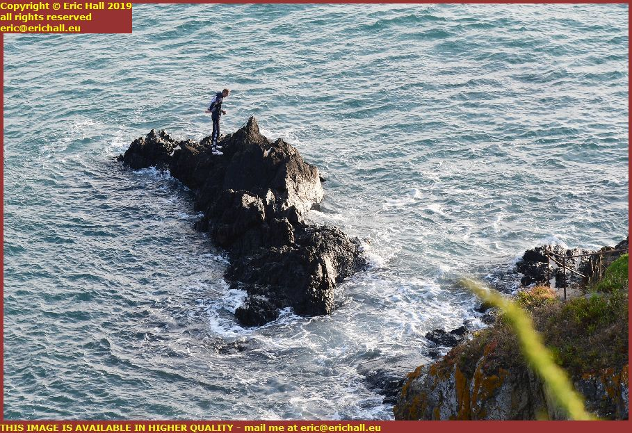 youth stranded on rock pointe du roc granville manche normandy france