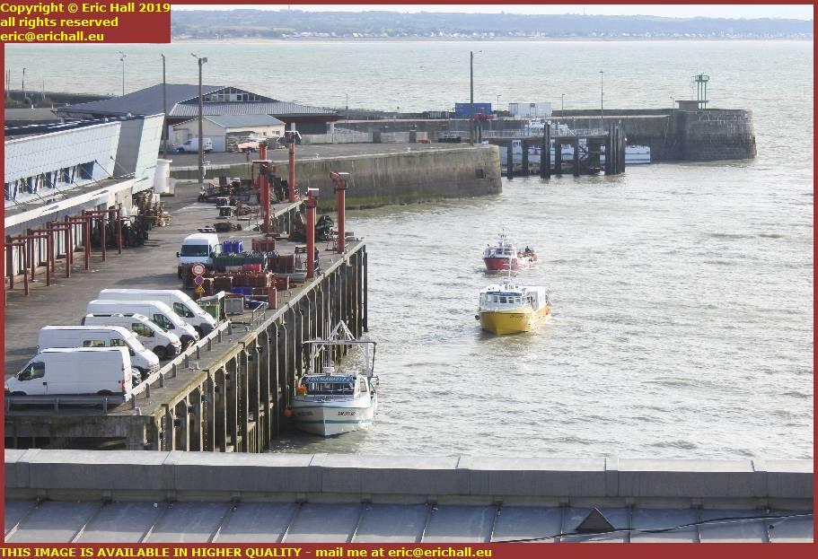fishing boats entering port de granville harbour manche normandy france