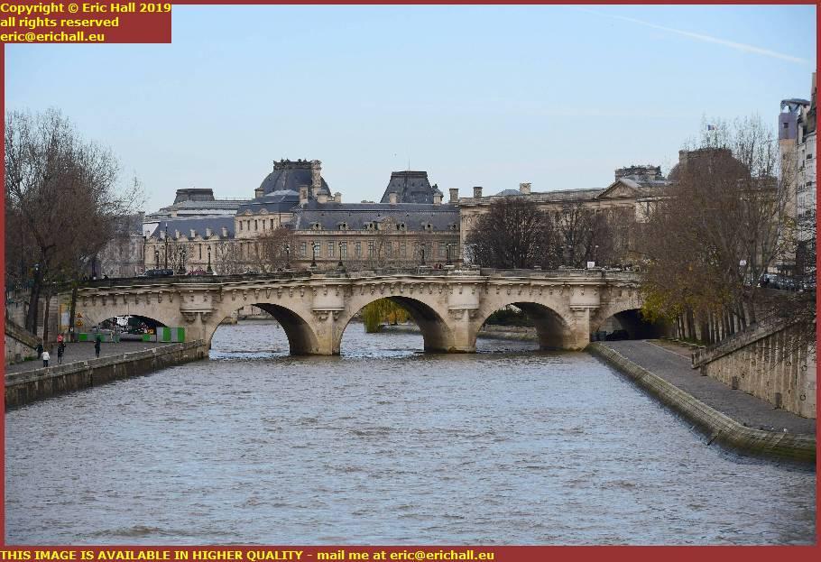 river seine pont neuf louvre museum paris france